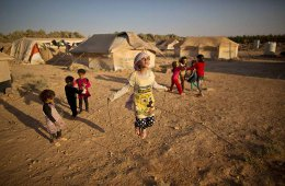 AP10ThingsToSee - Syrian refugee girl, Zubaida Faisal, 10, skips a rope while she and other children play near their tents at an informal tented settlement near the Syrian border on the outskirts of Mafraq, Jordan, Sunday, July 19, 2015. (AP Photo/Muhammed Muheisen)